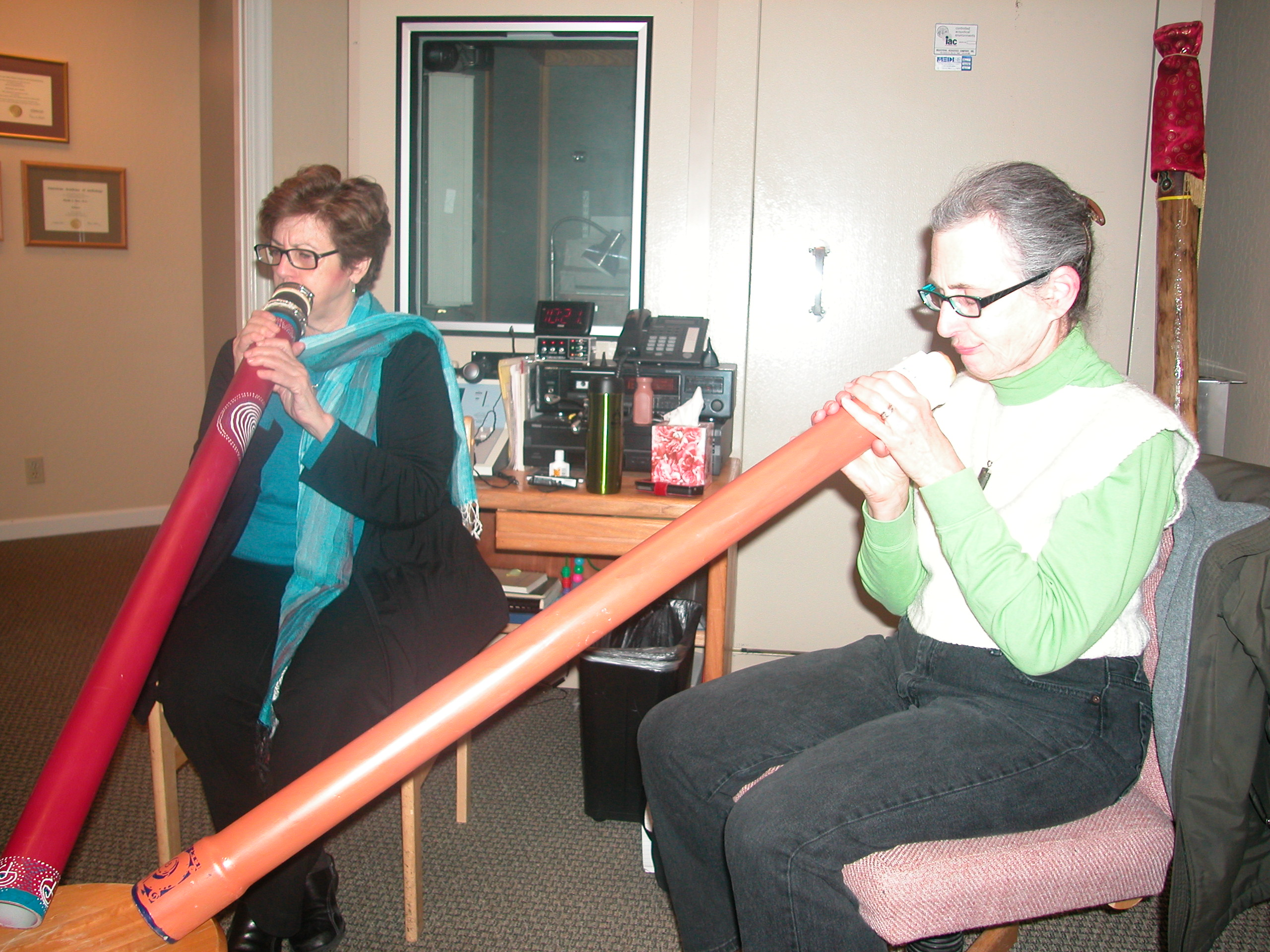 two students playing didgeridoo